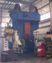 2500 ton FICEP screw press used for forging aluminum billets teated in Maestri chain-type oven