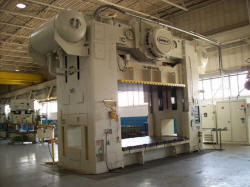 For sale used 600 Ton Danly mechanical press with T-slide and moving bolster
